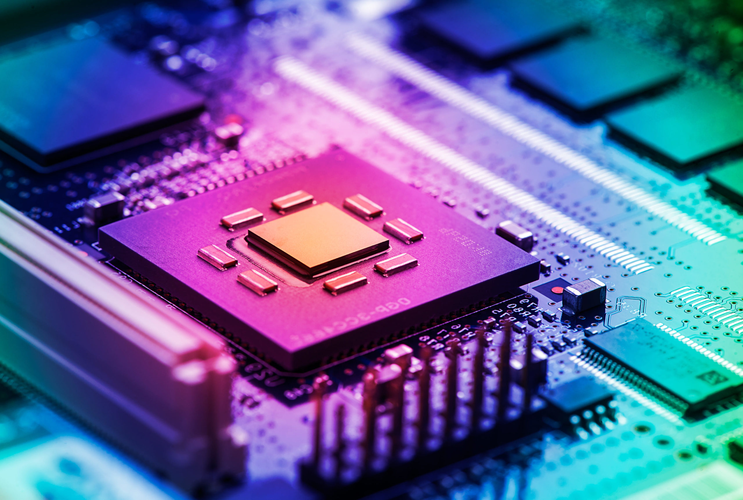 Intricate circuit board with a micro-chip illustrating the tech Sector